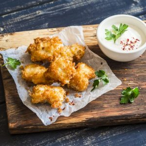 Crispy fried fish on a wooden rustic board